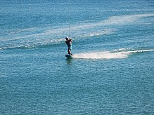 Wakeboard riding in the sea.
