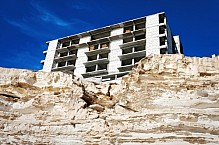 Construction of the building on the rocks.