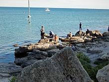 Fishermen on the seashore.
