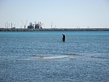 Man with a metal detector.