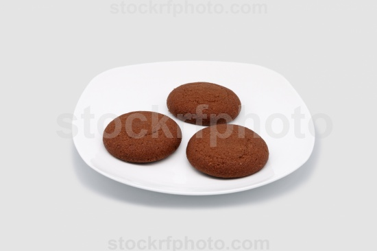 Oatmeal cookies on a white plate.