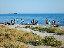 People on the shore of the Caspian Sea.