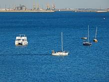 Yachts and boat at sea.
