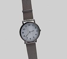 Wristwatch with a metal strap.
