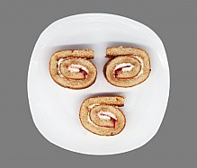 Sliced roll on a plate.